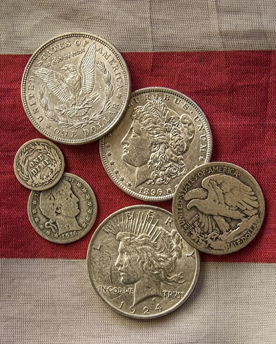 pile of silver coins gold/silver ratio